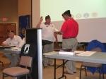 Commander Carlos Carlos L. Gallardo installing Brett Ragsdale as Service Office
